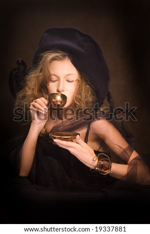 Young lady with a gold coffee cup (2)