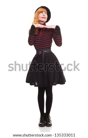 young lady with black beret and skirt isolated on white background - stock photo