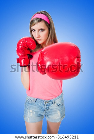 Young lady with boxing gloves on white