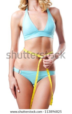 Young lady with centimetr in weight loss concept - stock photo