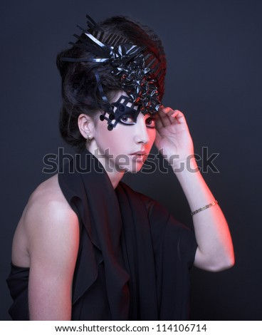 Young lady with creative visage and hairstyle