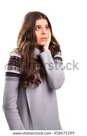 Young lady with horrified face. Woman in patterned sweatshirt. Stress and shock. What could have gone wrong. - stock photo