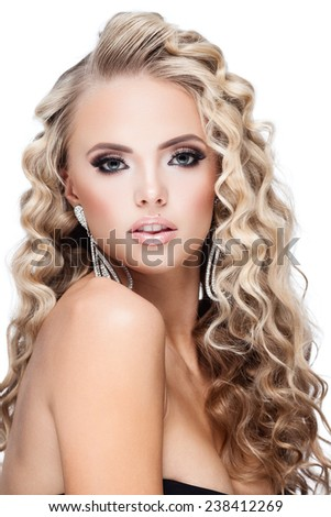 Young lady with luxury accessories on white background - stock photo