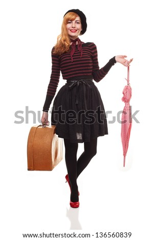 young lady with retro suitcase and umbrella posing for camera isolated on white background - stock photo