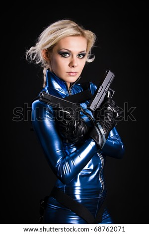 young lady with two guns - stock photo