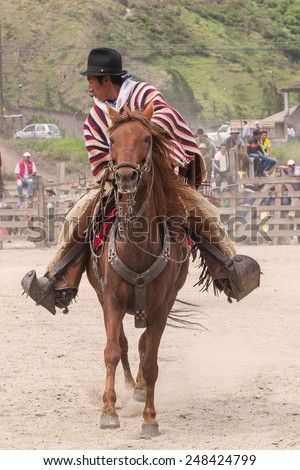 Young Latin Cowboy Riding A Horse At A Local Competition, South America  - stock photo
