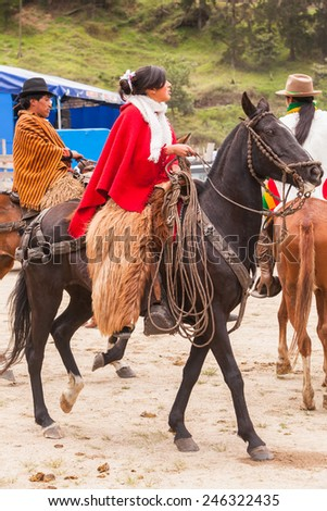 Young Latin Cowgirl With A Red Poncho Is Riding A Horse, South America  - stock photo