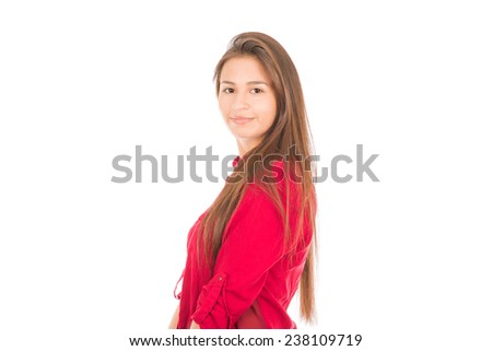 Young Latin Girl, wearing a pink shirt, standing and looking at the camera. Isolated on white.