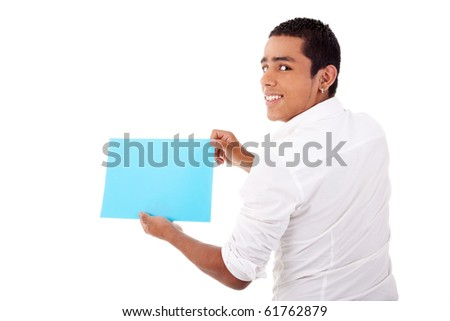 young latin man, from back, with blue  card in hand, smiling, isolated on white background. Studio shot. - stock photo