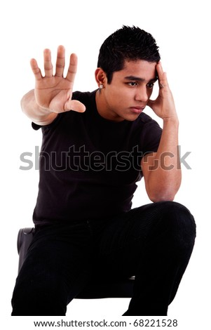 young latin man, pensive, with his hand in stop signal, isolated on white background, studio shot - stock photo