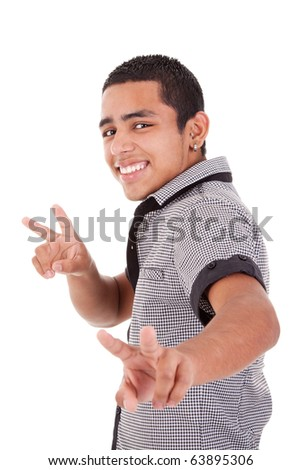 Young latin man with thumbs raised as a sign of victory, isolated on white background. studio shot - stock photo