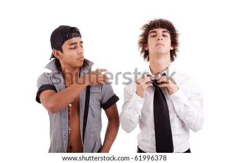 young latin men, gesturing  with a finger - removing something from the shoulder (a white boy), isolated on white, studio shot - stock photo