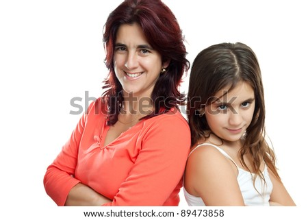 Young latin mother and her daughter  istanding back to back and smiling isolated on a white background