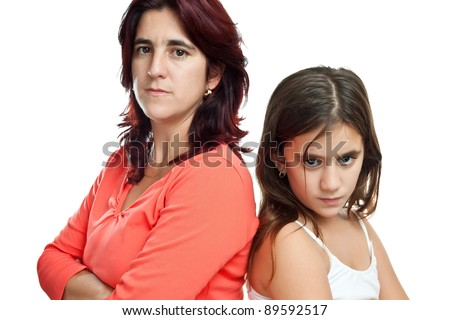 Young latin mother and her daughter mad at each other isolated on white - stock photo