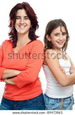 Young latin mother and her daughter  standing back to back and smiling isolated on a white background