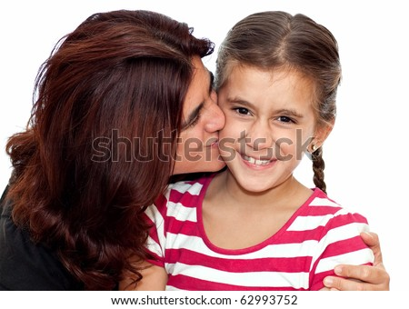 Young latin mother kissing her daughter who is making funny faces isolated on white