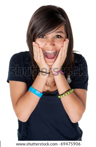 Young latina girl surprised and hands on chin with big smile on white background - stock photo