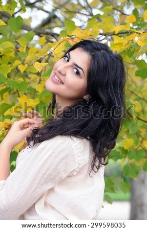 young latina woman in autumn