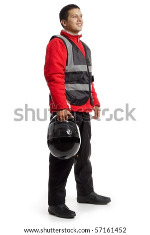 Young latino male wearing motorcycle suit, holding a helmet. - stock photo