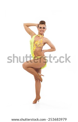 Young latino woman dancer posing on white background - stock photo