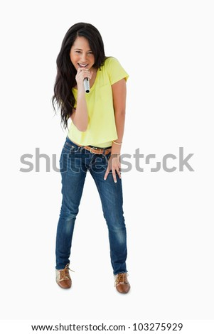 Young Latino woman holding a guitar against white background - stock photo
