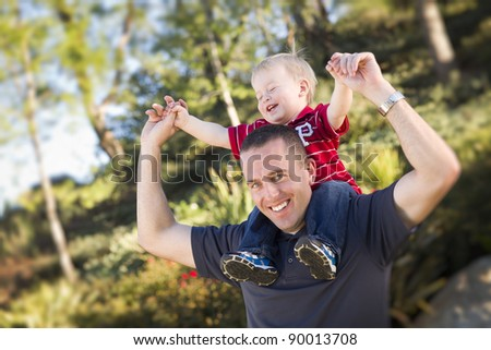 Young Laughing Father and Child  Having Piggy Back Fun. - stock photo