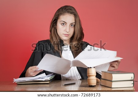 Young law school student reading files - stock photo