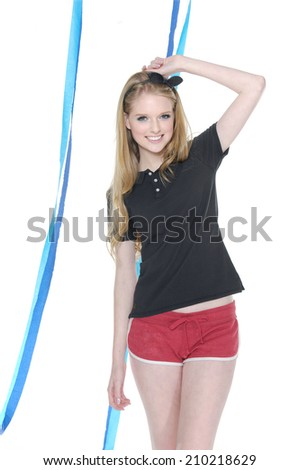 young leisure woman in shorts with blue ribbons posing on white