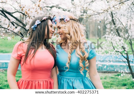 young lesbian couple in park - stock photo