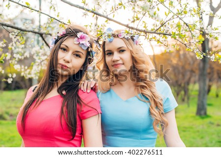 young lesbian couple in park during sunset - stock photo