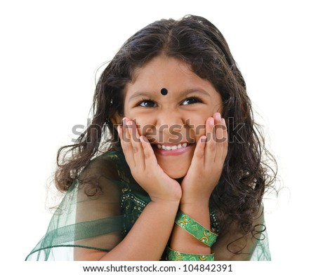 Young little Asian Indian girl smiling on white background - stock photo