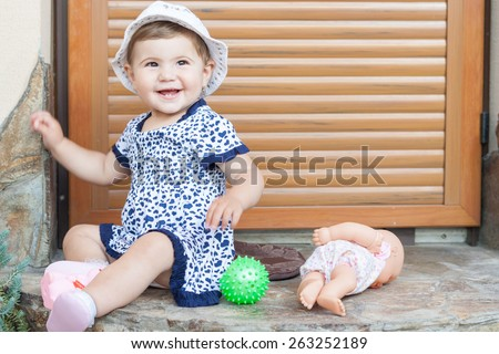 young little girl smiling and having fun. - stock photo