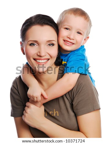 young little son embracing his pretty young mother - stock photo