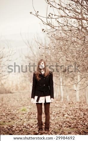 Young lone girl staring at camera. - stock photo