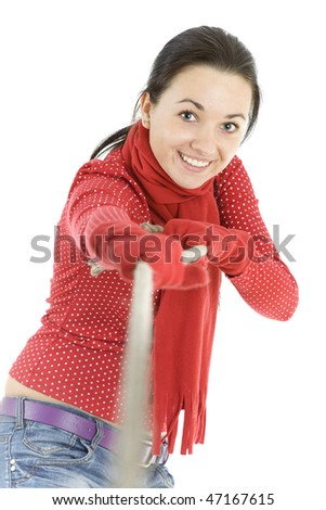 young, long hair, girl pulling grey rope, tug-of-war - stock photo