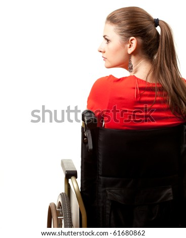 young long hair invalid woman on the wheelchair - stock photo