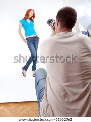 young long hair woman in turquoise blouse posing - stock photo