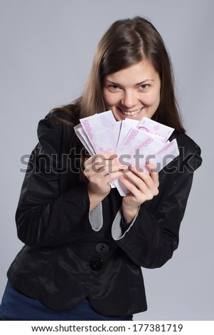 Young long-haired woman holding euros in a fan-shape in his hand - stock photo