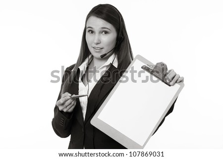 young looking woman in a suit wearing a headset holding a clip board - stock photo
