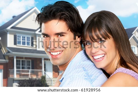 Young love couple a new home.  Real estate concept - stock photo