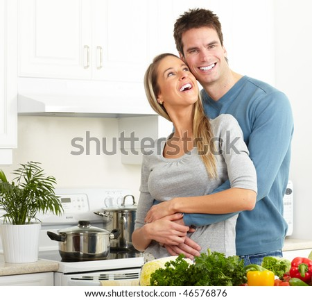 Young love couple cooking at kitchen - stock photo