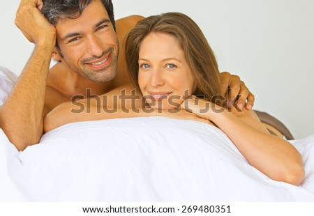 Young love couple in bed - stock photo
