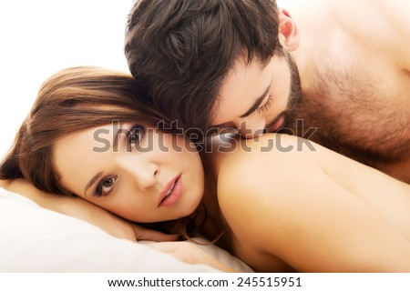 Young love couple in bed, romantic scene in bedroom. - stock photo