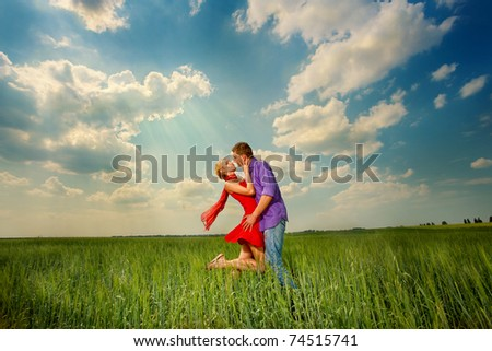 Young love Couple kiss under blue sky