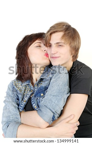 Young love couple kissing over white background, valentine day concept - stock photo