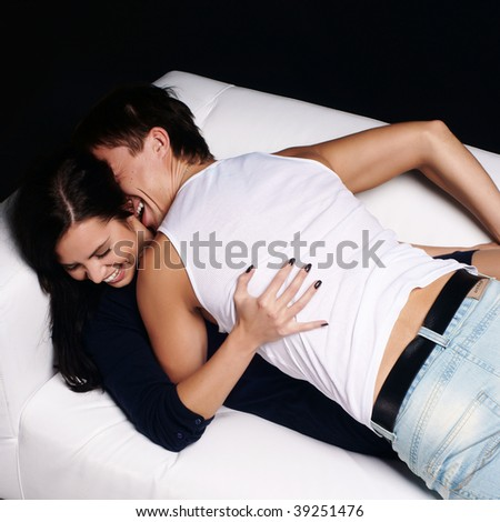 Young love couple resting in the comfortable apartment - stock photo