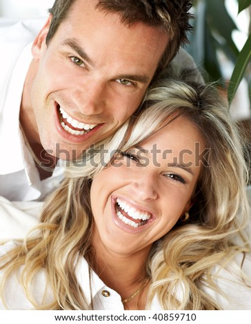 Young love couple smiling at home - stock photo