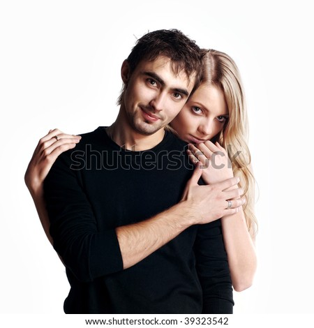 Young love couple smiling. Over white background - stock photo
