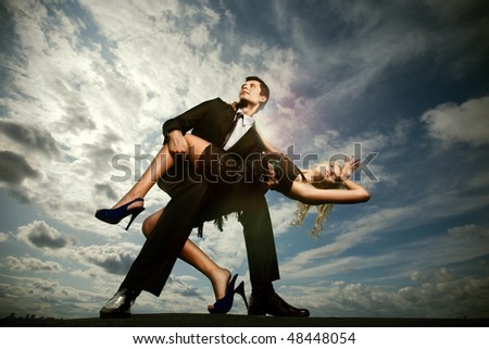 Young love Couple under blue sky - stock photo