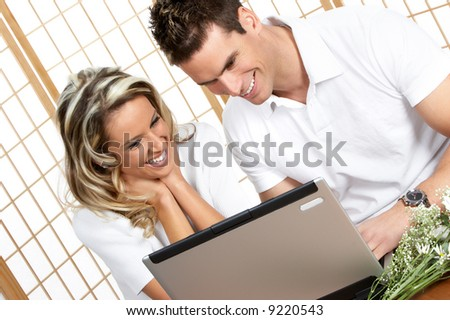 Young love couple with laptop. Over white background - stock photo
